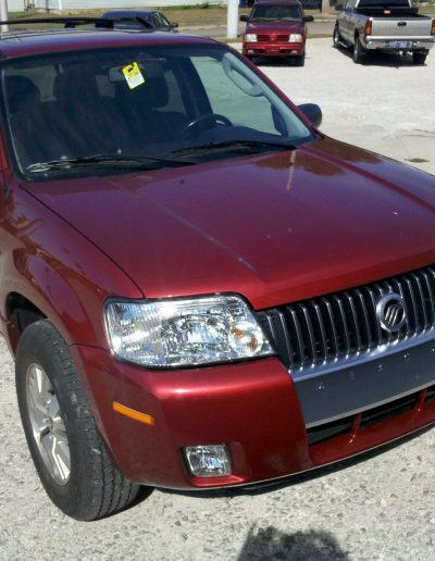 After photos of a red SUV repaired by Blackburn Collision Center