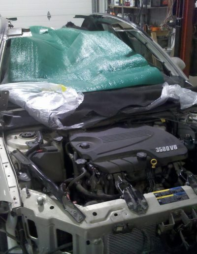 A silver Chevy being repaired at Blackburn Collision Center
